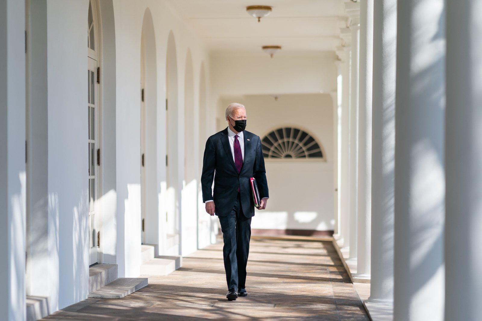 Biden walking through the White House