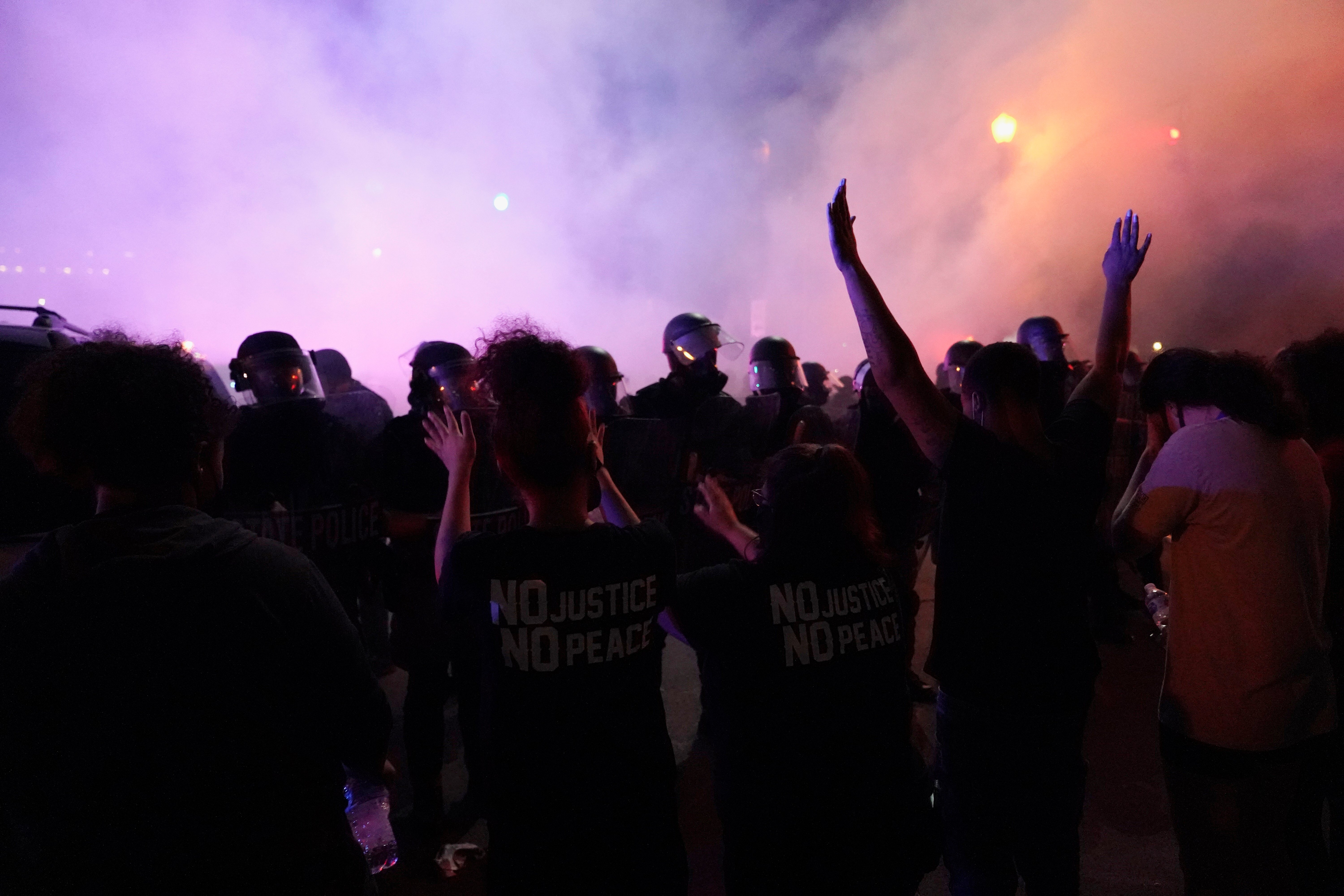 Tear gas is deployed into a Louisville, Kentucky, crowd on May 29, 2020. Several WLKY News crews reported being assaulted by protesters that evening. REUTERS/BRYAN WOOLSTON