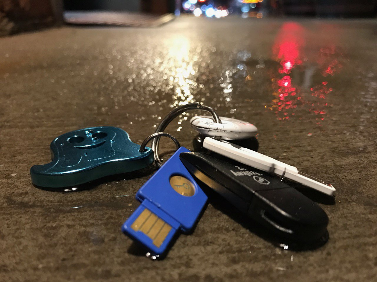 Security keys on a cold, wet NYC sidewalk