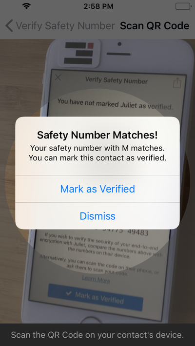 Screenshot of a safety number being scanned in the Signal app.